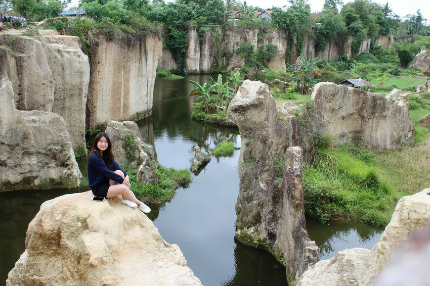 EyeEmNewHere Rock - Object Adults Only Outdoors Adult Water Tree Smiling Happiness Adventure Girl Cliff Climbing Girl Power Beautiful Indonesia
