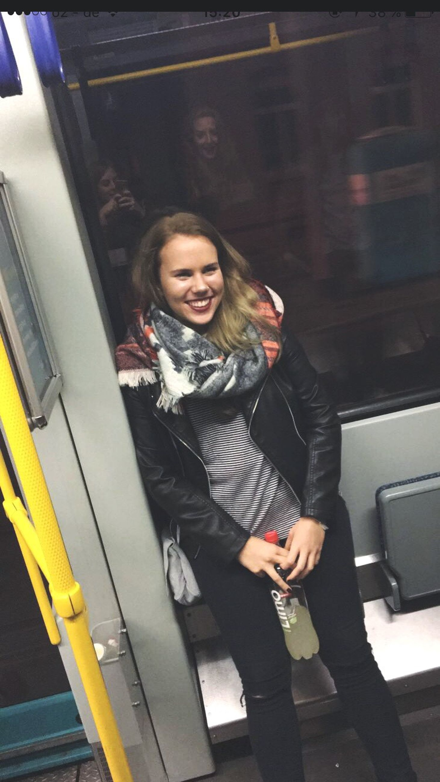 indoors, transportation, sitting, casual clothing, young adult, front view, relaxation, full length, young women, mode of transport, person, looking at camera, subway train