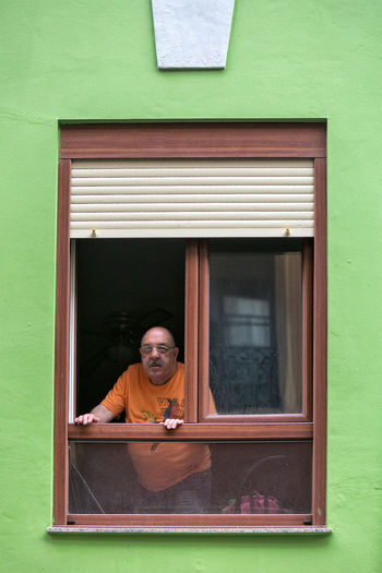 I was photographing the window when the man came out. Architecture Day Green Color History In Front Of Looking At Camera Memories People People Photography Portrait Streetphotography Waist Up Window Window Frame