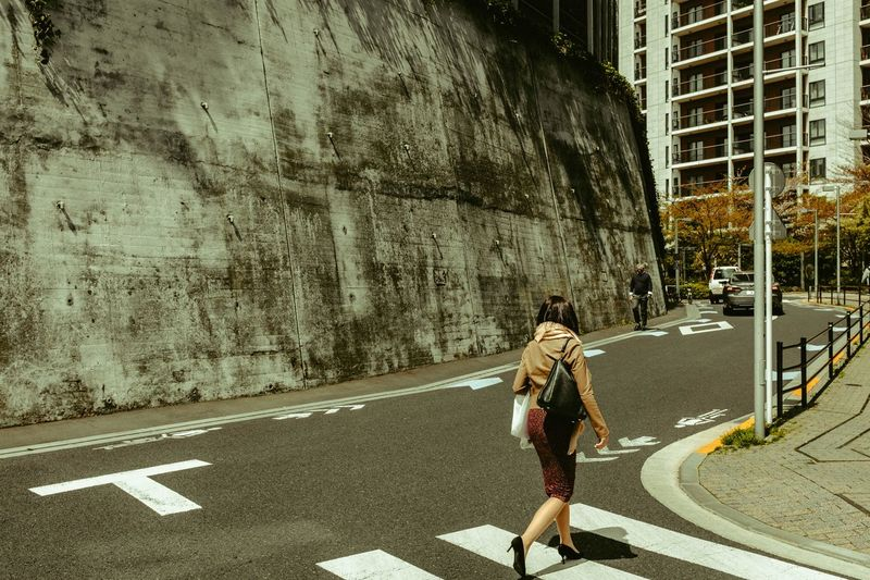 Real People Road One Person Symbol City Road Marking Architecture Lifestyles Street Women Day Sign Outdoors