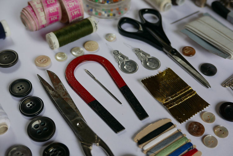 High angle view of sewing kit arranged on table