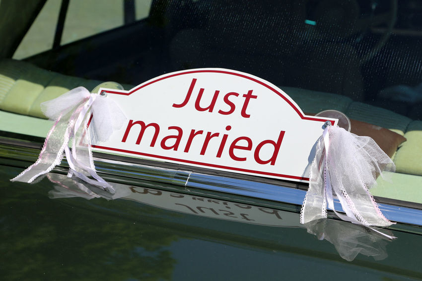 """Just married"" sign on the back of a sedan car Close-up Communication Day No People Outdoors Text Water Just Married Just Married! Marriage  Wedding Wedding Photography Wedding Dress Wedding Day"