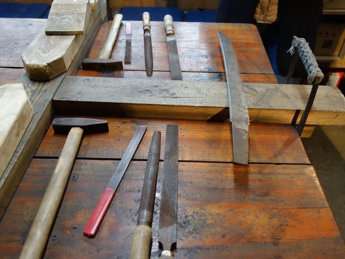 High angle view of work tools and workbench