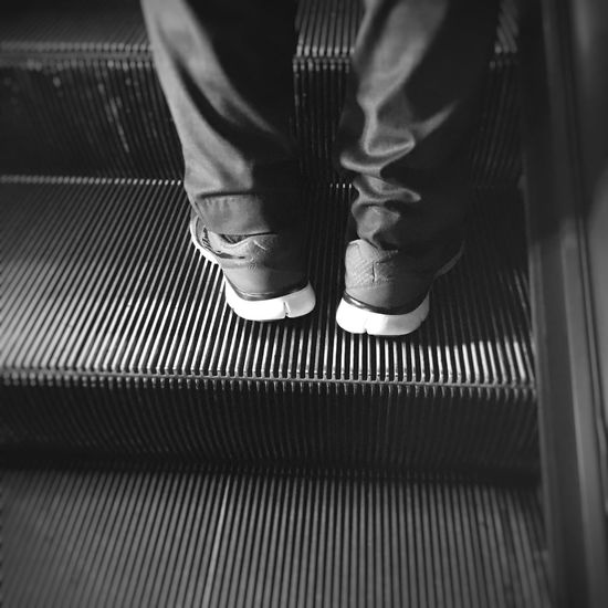 Washington DC. Metro escalator. Real People Low Section Human Leg Shoe Standing One Person Close-up Escalator Escalators Escalators And Steps Escalators And Staircases