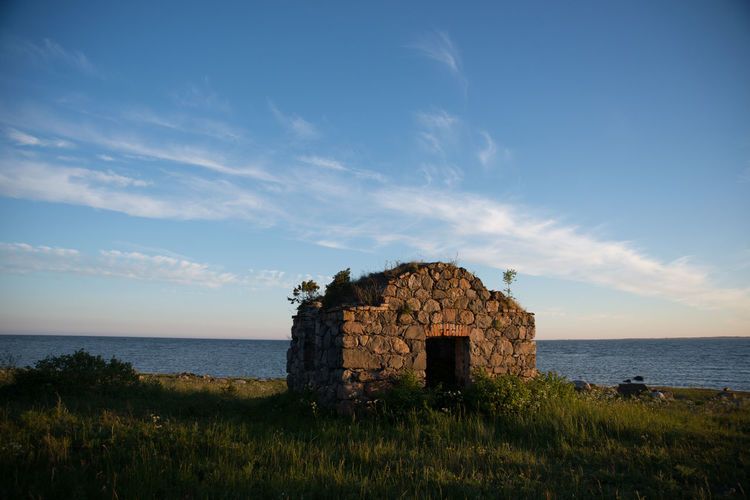 Old Built Structure At Beach Against Sky