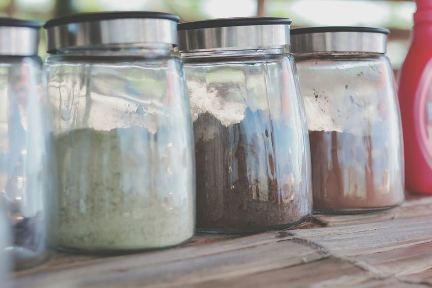 Glass bottle in coffee shop. Esspresso Cappuccino Latte Machiatto Roast Cocoa Powder Glass Wooden Table Coffee Macha Green Tea Bevarage Drink Caffeine Food Delicious Tea Barista Lifestyles Jar Close-up Food And Drink Preserved Frothy Drink Black Coffee