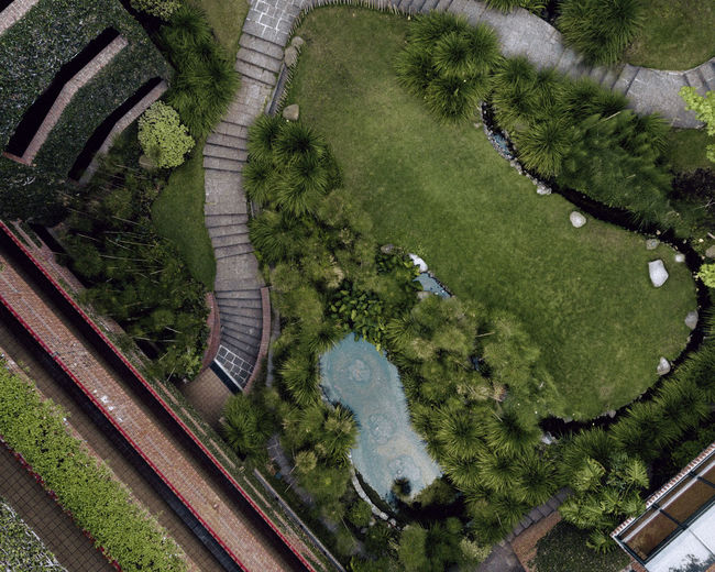 Aerial View Architecture Beauty In Nature Day Environment Grass Green Color Growth High Angle View Nature No People Outdoors Plant Reflection Scenics - Nature Tranquility Transportation Tree Water