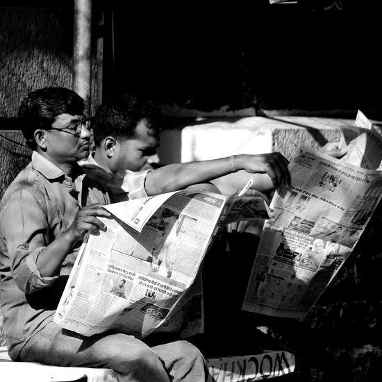 Caption : Todays Headlines. Clicked at CST, Mumbai. Two People Sitting Men Streetphotography_bw Blackandwhitephotography First Eyeem Photo