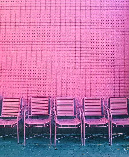 Chairs against purple wall