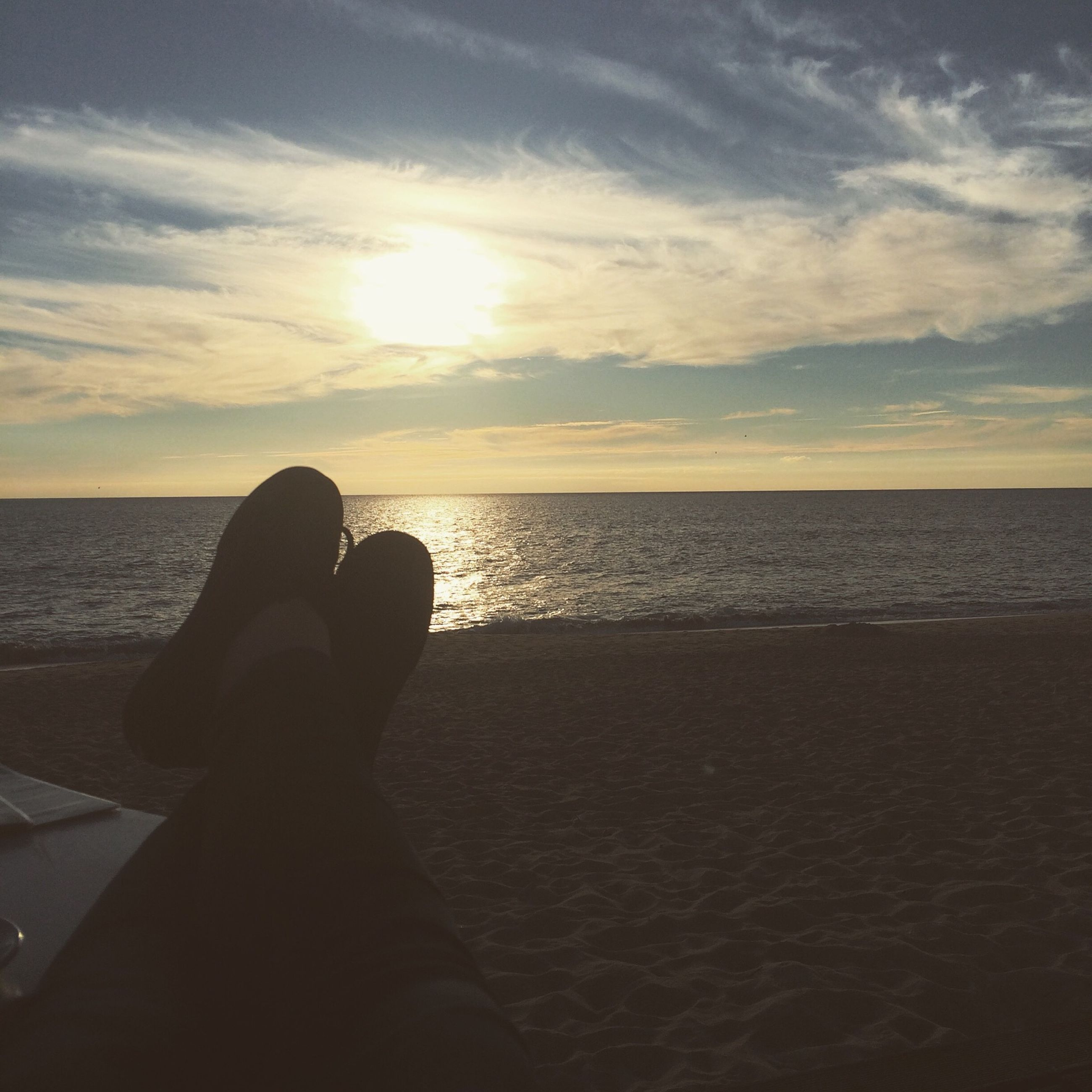 sea, water, horizon over water, sky, sunset, beach, scenics, tranquility, tranquil scene, beauty in nature, silhouette, lifestyles, leisure activity, cloud - sky, personal perspective, nature, unrecognizable person, relaxation