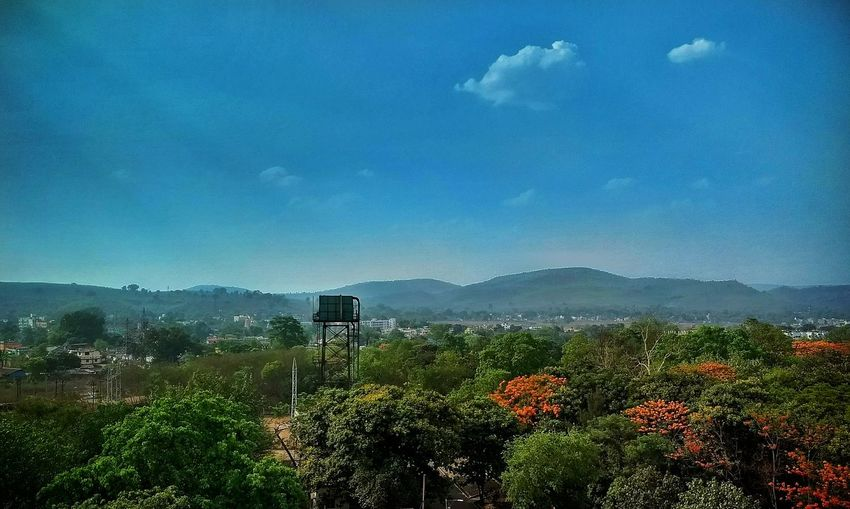 Valleys Beauty In Nature Nature No People Sky Mountain Hills And Valleys Hills, Mountains, Sky, Clouds, Sun, River, Limpid, Blue, Earth Indiapictures Freshness Day Tree Outdoors Flower Flowers,Plants & Garden Lanscape Photography Lansdcape Indiaclicks Watertank From My Point Of View Summerdays  Bluesky