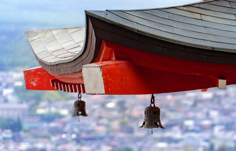 Built Structure Red Architecture Day Building Exterior No People Nature Hanging Sky Focus On Foreground Flying Outdoors Building Roof Low Angle View Religion Belief Place Of Worship Spirituality