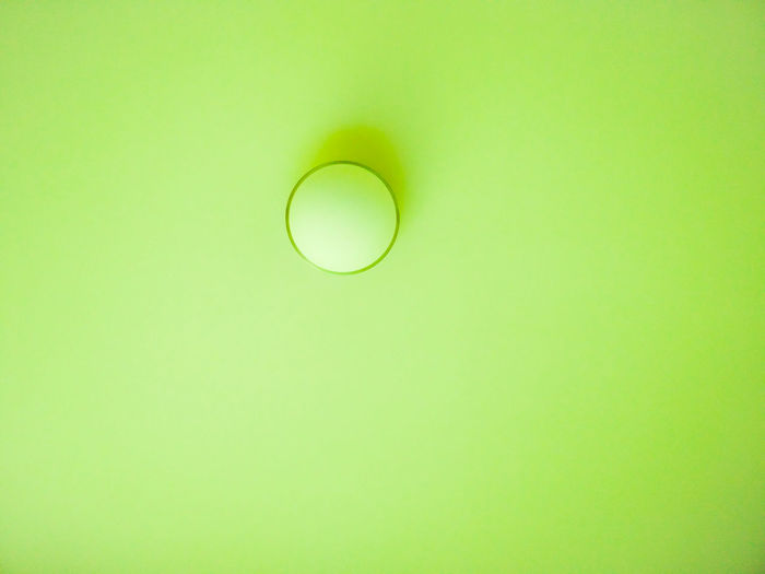 Close-up of light bulb over black background