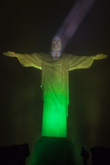 Brazil Cristo Redentor Rio De Janeiro A America Green Color Human Representation Illuminated Low Angle View Night No People Outdoors Religion Religious Architecture Sculpture Sky South America Statue