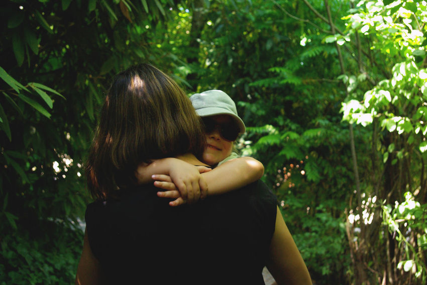 Family Green Happiness Mother & Daughter The Portraitist - 2018 EyeEm Awards Bonding Child Childhood Daughter Embracing Emotion Family Family With One Child Innocence Leisure Activity Love Mother Parent Plant Positive Emotion Real People Scenery Scenics Togetherness Women