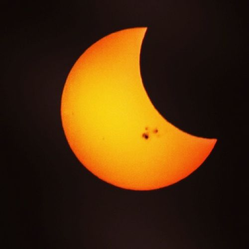Shot numero dos.. the little spots on the sun are what are called solar flares. SubhanAllah Partialeclipse YYC Solareclipse2014 Canonphotography 300mm Closeup Beauty Universe Astronomy Spacephotography Instawesome Instalove Instacaptured Beautyinthevastworld Sunmoon