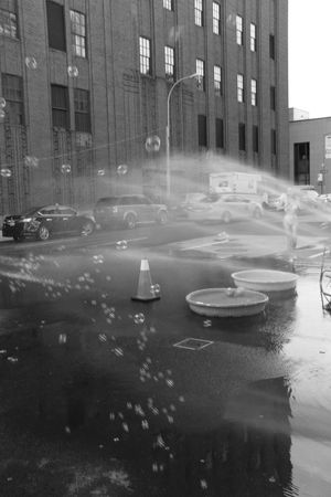 Bubbles New York Playing With Water Black And White Black And White Photography Building Exterior City City Life Cityscape No People Street Water