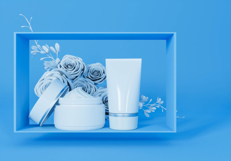 Close-up of white flower on table against blue background