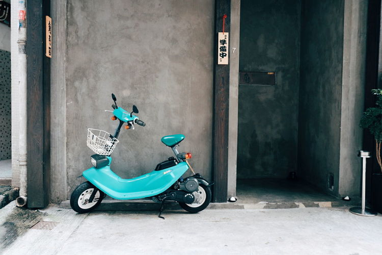 Turquoise. Motorcycle Outdoors City Building Exterior