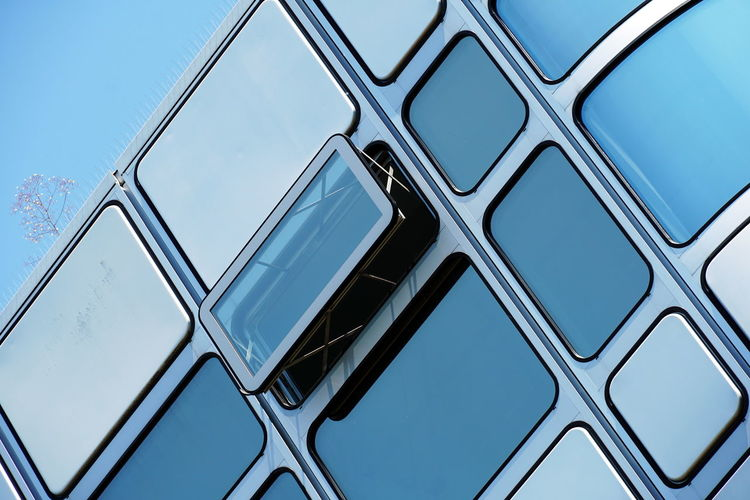 Low angle view of metallic structure against clear blue sky