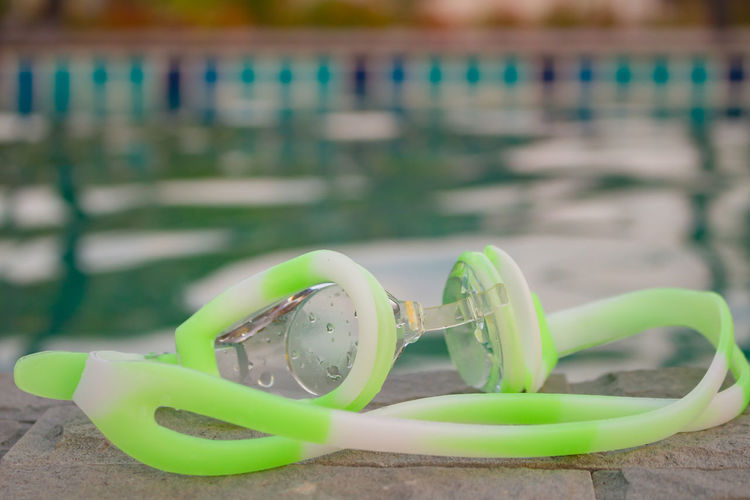 Diving Glasses Focus On Foreground Water Close-up Personal Accessory No People Nature Glasses Green Color Day Table Still Life Outdoors Land Beach Selective Focus Swimming Pool Eyewear Plastic Wood - Material Turquoise Colored Diving Equipment Diving