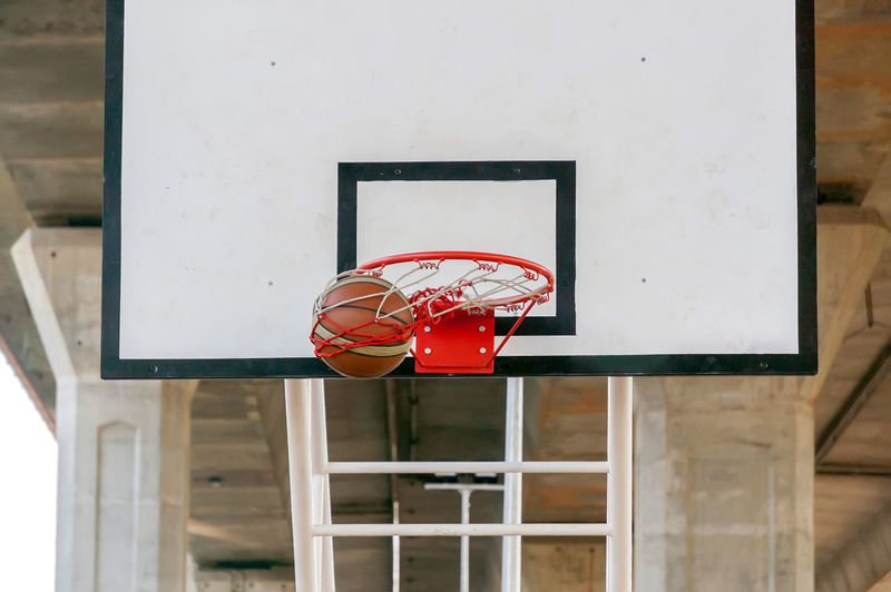 Low Angle View Of Basketball Hoop Against Sky Basketball Hoop Basketball - Sport Sport Red No People Ball Day Architecture Built Structure Net - Sports Equipment Sports Equipment Focus On Foreground Outdoors Low Angle View Metal White Color Close-up Court Leisure Games