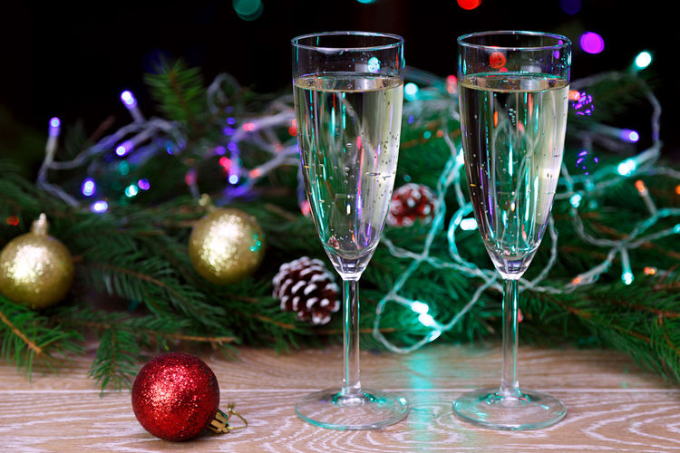 Celebration Bokeh Mery Christmas Christmas Lights Christmas Spirit Christmas Celebratory Toast Bokeh Effect Human Hand Drink Holding Alcohol Christmas Around The World Beverage Cheers Wine Bubbly Champagne Toast Two People Drinking Glass Cheers To Life Alcohol Drinks Christmas Eve New Year