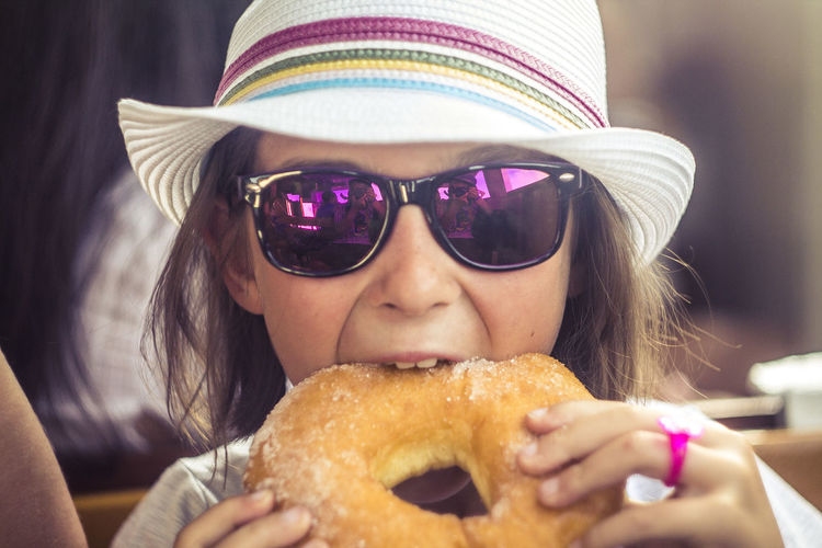 Close-up of cute girl eating donut