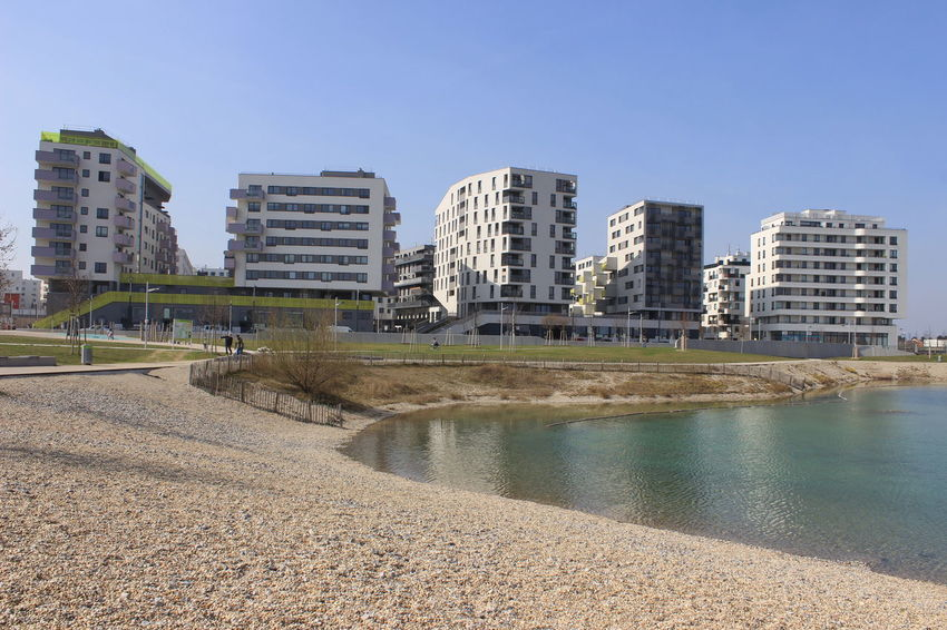 Seestadt Aspern Vienna Architecture Building Exterior Built Structure City Clear Sky Day Modern Outdoors Sand Water