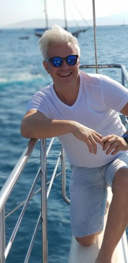 Portrait Of Man Wearing Sunglasses On Boat