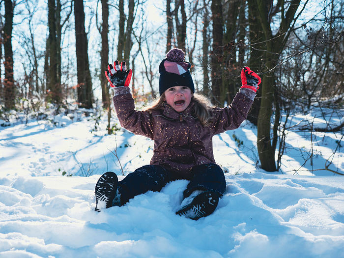 Full length of child in snow on field
