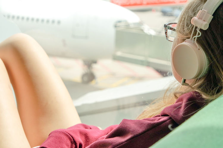 Earphones Glasses Listening Listening To Music Relaxing Transportation Traveling Waiting Wandering Airport At The Airport Close-up Day Ear Earpods Girls Headshot Human Hand Indoors  Long Hair One Person Real People Waching Airplanes Be. Ready.