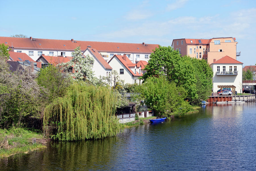 Rathenow, Brandenburg/ GERMANY May 06 2013: Cityscape of Rathenow (Germany) with Havel river and traditional houses. Havel River Havelland Germany Rathenow Architecture Building Exterior Built Structure Day Havel Havelland House Outdoors Plant River Tree Water