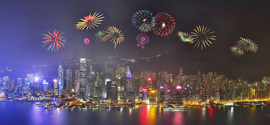 Night view and fireworks at victoria harbour, Hong Kong Annual Event Celebration Chinese New Year Cityscape Downtown District Exploding Firework - Man Made Object Firework Display Fireworks In The Sky Holiday - Event Hong Kong Night No People Outdoors Party - Social Event Reflection Sky Skyscraper Victoria Harbour Water
