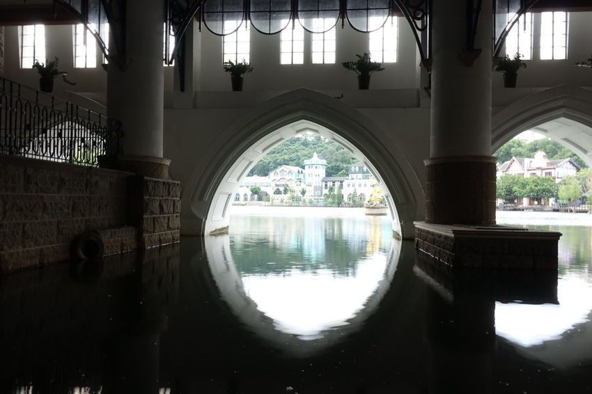 Interlaken Hotel Shenzhen. View from Underground over the Lake Arch Architectural Column Architecture Archway Bogen Bridge - Man Made Structure Canal China China Photos Diminishing Perspective Double Entrance Groundlevel Interlaken Lake Reflection Reflection Reflektion Shenzhen Standing Water Tourism Travel Destinations Underneath Water