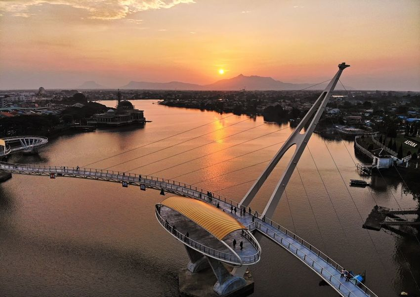 Darul hana golden bridge at sunset Sunset Sunset_collection River Riverside Waterfront Landscape Outdoors High Angle View Aerial View Aerial Photography Reflection EyeEm Selects EyeEm Gallery EyeEm Best Shots Eyeemphotography Travel Beautiful Travel Destinations Bridge Structure Architecture Landmark Water Nautical Vessel Sunset Beach Sea City Orange Color Sky Building