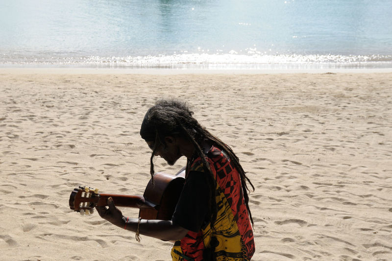 Seggae man in Mauritius, Indian Ocean. Seggae is a fusion genre of sega, the traditional music of the Mascarene Islands, and reggae. Beach Mauritius People And Places Reggae Sand Sea Seggae Shore Tourism Travel Destinations The Portraitist - 2018 EyeEm Awards