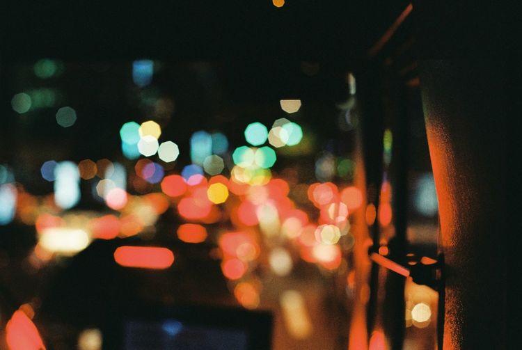 Close-Up Of Illuminated Lights In City