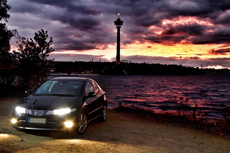 MeinAutomoment Suomi Finland Tampere Näsinneula Lake Sunset Clouds And Sky Storm Honda Civic Car My lovely Honda by the lake. It was really, really windy and the sky was on fire Multivisio Showcase June The Drive