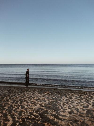 A man and the sea. Gdańsk, Poland. Landscape EyeEm Best Shots EyeEm Best Shots - Nature Water Sea Full Length Clear Sky Beach Sand Wave Standing Summer Sky Calm Seascape Silhouette Horizon Over Water Sunset