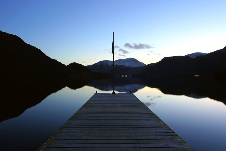 Ullswater Beauty In Nature Day Jetty Lake Mountain Nature No People Outdoors Reflection Scenics Silhouette Sky The Way Forward Tranquil Scene Tranquility Ullswater, Lake District, Water Wood Paneling