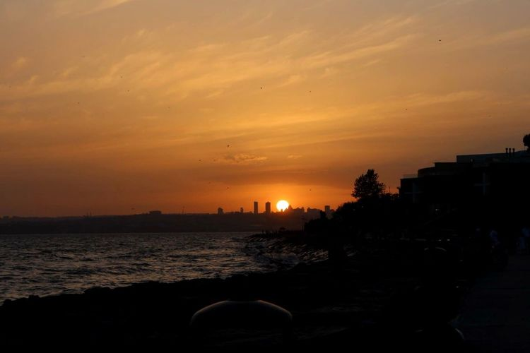 Istanbul Turkey Enjoying The Sun Eye4photography  Sunset Silhouettes Peoplephotography Istanbul Colour Portrait Sunset Nature Summer