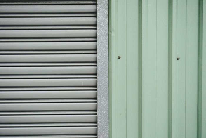 Closed Close-up Shutter Door Privacy Full Frame Vibrant Color Blinds Green Blue Green Color Blind Lines, Shapes And Curves No People Outdoors The Graphic City