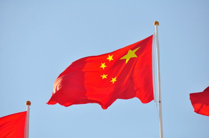 Low angle view of flags of china