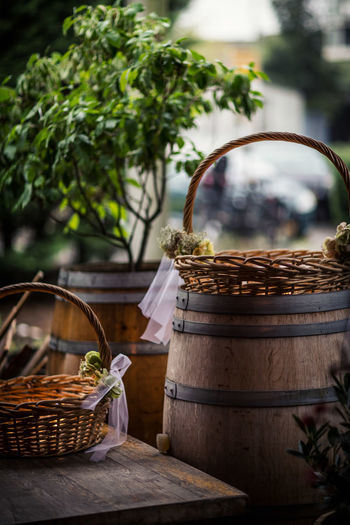 Baskets and winebarrel in a romantic setting with soft lighting Basket Group Of Objects No People Plant Romantic Rural Scene Selective Focus Table Wedding Winebarrel Wood - Material