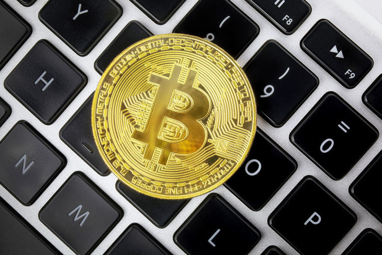 Gold metal coin of cryptocurrency, bitcoin. Computer keyboard background. View from above. BTC Currency Finances Gold Market Virtual XBT Bitcoin Coin Business Coin Computer Computer Equipment Computer Keyboard Computer Network Computer Part Connection Electronics Industry Exchange Finance Internet Keyboard Metal Money Ring Technology