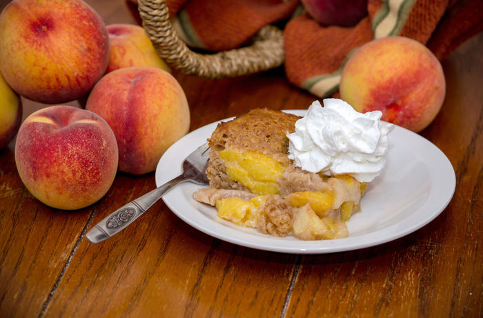close up of peach cobbler with whipped cream Agriculture Dessert Fresh Produce Hello World Nature Orange Summertime USA Vitamins Food Fresh Fruit Healthy Eating Home Made Juicy Just Picked Michigan Peaches Organic Peach Peach Cobbler Peaches Produce Sweet Tasty Yellow