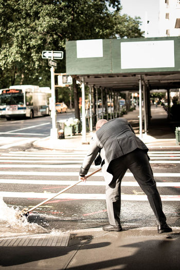 Man crossing road in city