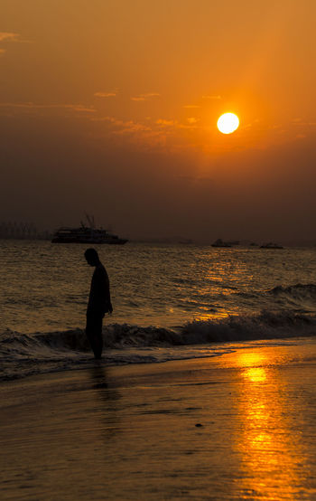 Sunset Sea Silhouette Orange Color Sun Vacations Water Nautical Vessel Business Finance And Industry Beach Tourism Travel Fishing Sky Nature Travel Destinations Tranquility Fisherman Horizon Over Water Landscape