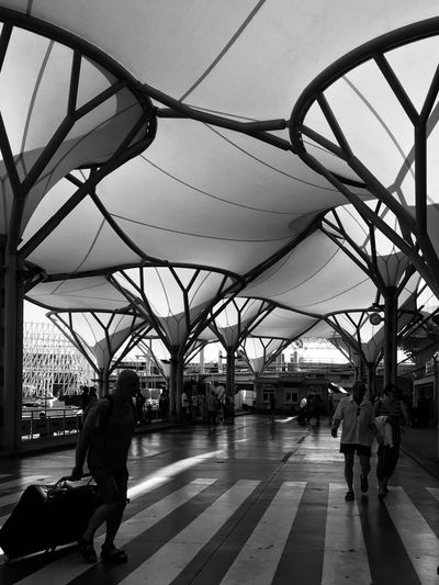 Time To Fly Airport Split Croatia Traveling Vacation Streetphotography Blackandwhite Monochrome Bnw Architecture Transportation Real People Built Structure Men Group Of People Day Walking City Connection People Lifestyles Travel Incidental People Women